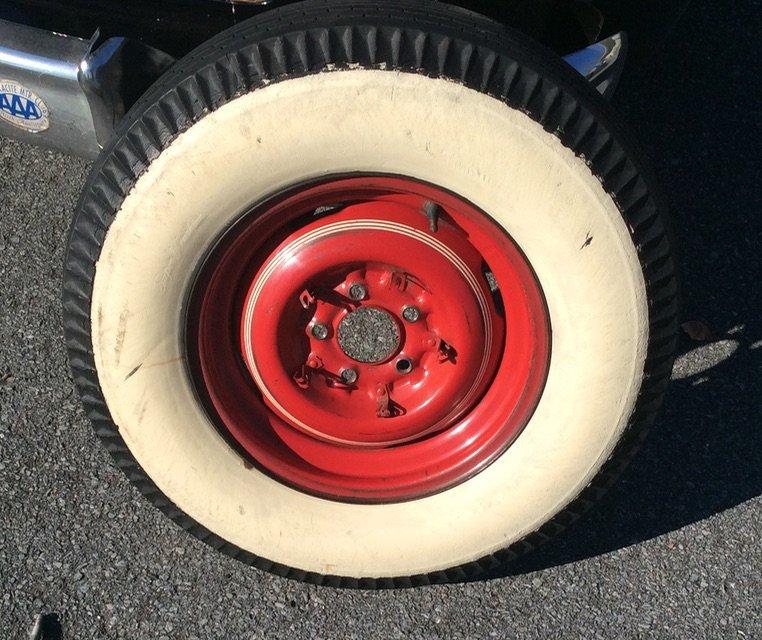 White wall side of original tire on original rim