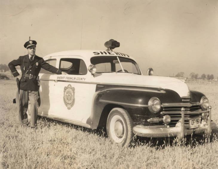 1948 Columbus OH Shepard N Edmonds Jr. is pictured here with a Franklin County Sherrif car. Edmonds became a deputy Nov 1, 1947 and was discharged in March of 1950.jpg